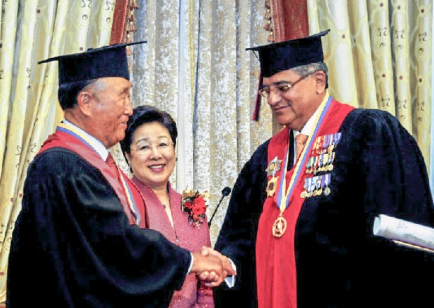 True Father receives an honorary doctorate from the University of Bridgeport September 7, 1995.